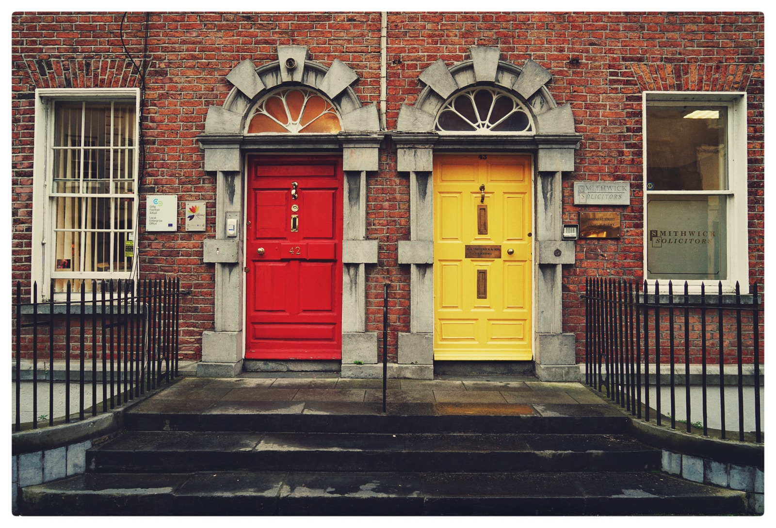 two yellow and red wooden doors